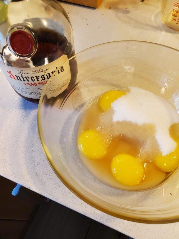 Egg yolks, rum, and sugar.
