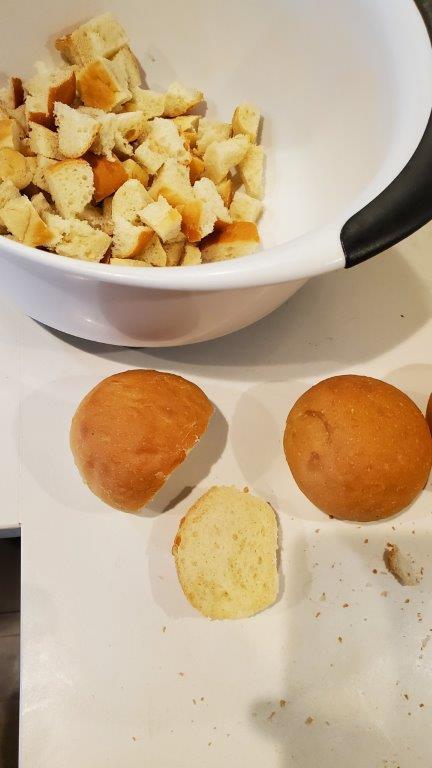 Bread rolls being cut up